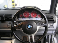 red custom bmw x5 dials